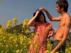 Horny and very nasty dark brunette gladly copulates on a flower field