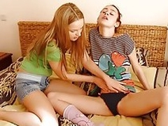 Two lesbian teenies kissing