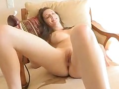 Beauty widens legs wide and begins playing with vibrator